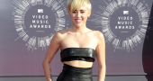 Miley Cyrus happy to go to dinner covered in pig poo